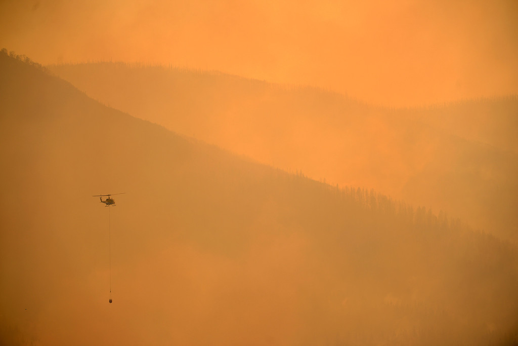 . A helicopter works the fire as the West Fork Fire continues to burn near Creede. The West Fork Fire grew to more than 70,000 acres overnight. (Photo by AAron Ontiveroz/The Denver Post)