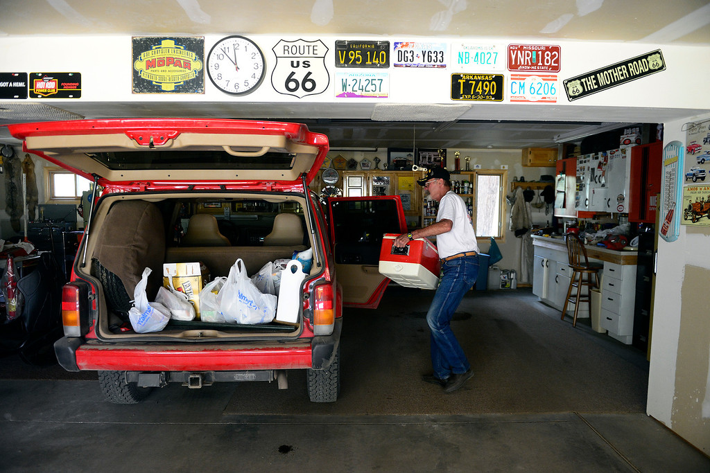 . Ron Marx gathers food and other supplies in his home as the West Fork Fire continues to burn near South Fork. Marx and his wife Bee were allowed into their home for 15 minutes to gather items. The West Fork Fire grew to more than 70,000 acres overnight. (Photo by AAron Ontiveroz/The Denver Post)