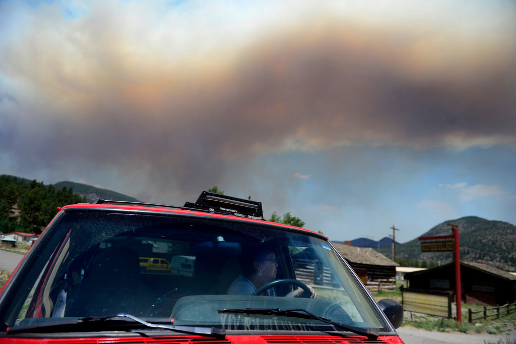 . Bee Marx looks back after leaving her home as the West Fork Fire continues to burn near South Fork. Marx and her husband Ron were allowed into their home for 15 minutes to gather items. The West Fork Fire grew to more than 70,000 acres overnight. (Photo by AAron Ontiveroz/The Denver Post)
