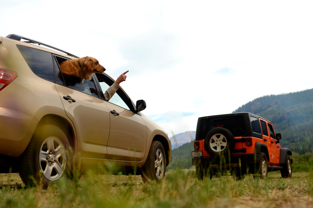 . Jack Kurtz points out the window while watching the Papoose fire with his dog Kallie near Creede. The three fires that make up the West Fork Complex fire now top out at more than 70 thousand acres. (Photo by AAron Ontiveroz/The Denver Post)