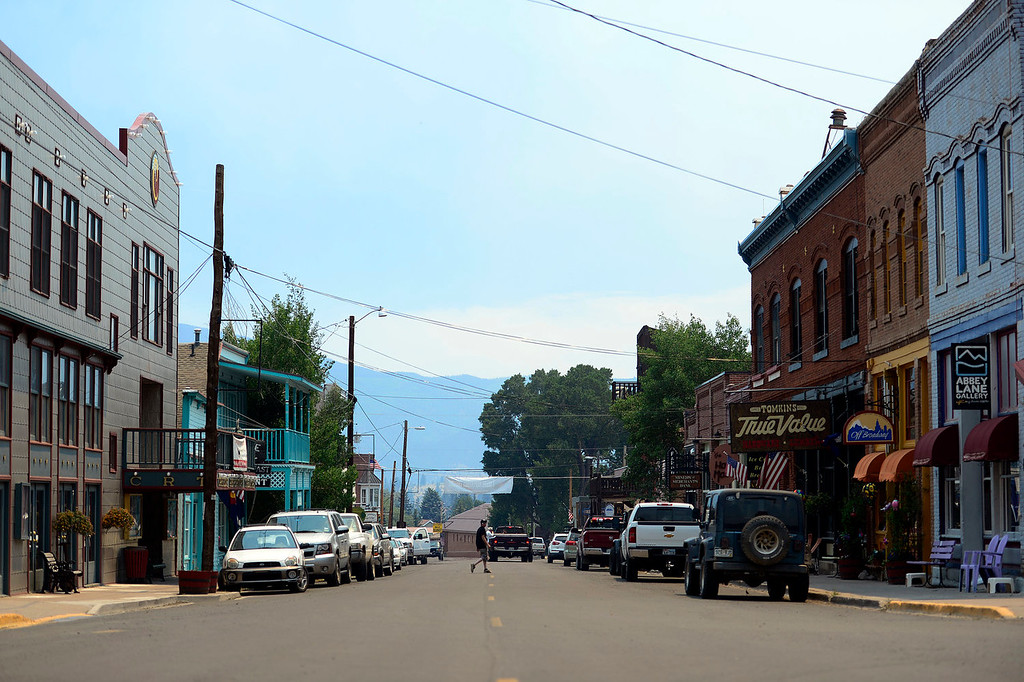 . An empty Main Street in Creede. The West Forest Complex fire continues to burn as it feeds on vast amounts of beetle kill in the surrounding forest. As a result, Creede, a town that relies on the summer months\' cash flow to get them through long winters is as empty in June as anyone in the area can remember. (Photo by AAron Ontiveroz/The Denver Post)