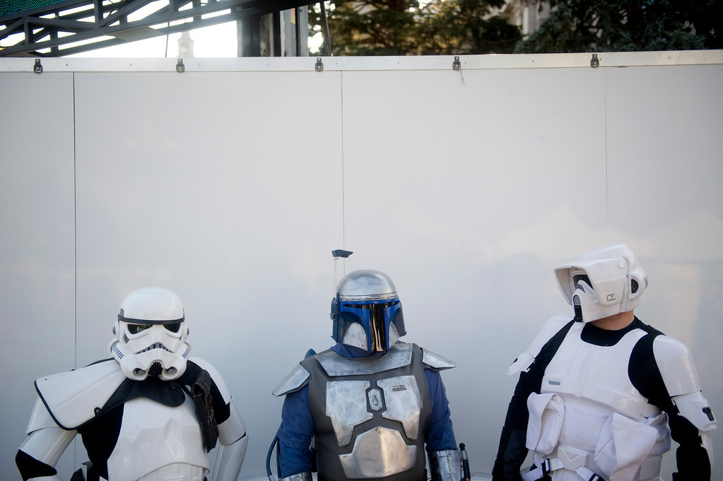 . DENVER - JULY 3: People dressed in costume as Storm Troopers and Jango Fett of Star Wars wait in between taking pictures with spectators before fireworks at Civic Center Park in Denver on July 3, 2013. (Photo By Grant Hindsley/The Denver Post)