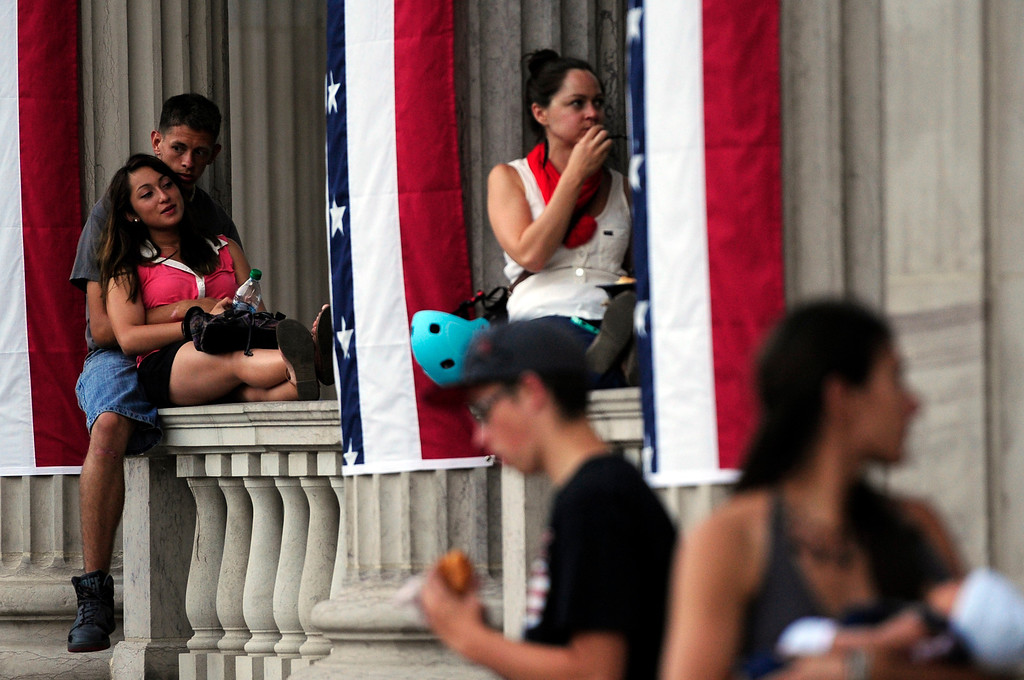 . DENVER, CO - JULY 3: From left, Ashley Perry and Joshua Mendoza sit together on the balcony awaiting fireworks before the city of Denver\'s annual fireworks show off the City and County Building in Civic Center on July 3, 2013, in Denver, Colorado. (Photo by Daniel Petty/The Denver Post)