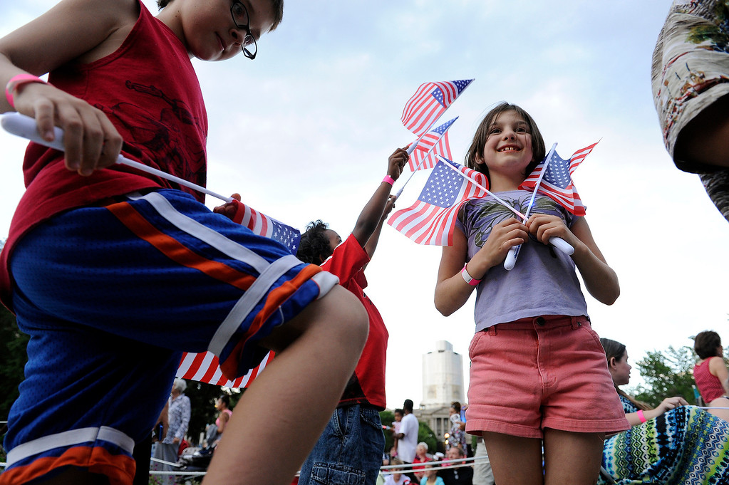 . DENVER, CO - JULY 3: Evan Ostrander, 9, left, and Dravyn Welchman, 9, right, play in Civic Center with other children before the city of Denver\'s annual fireworks show off the City and County Building on July 3, 2013, in Denver, Colorado. (Photo by Daniel Petty/The Denver Post)