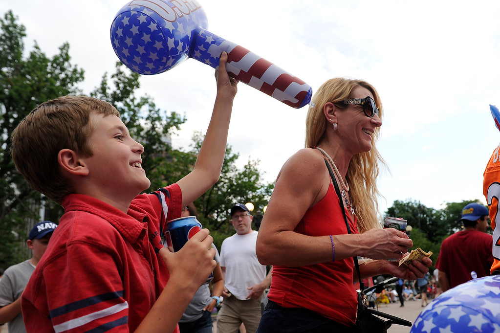 . DENVER, CO - JULY 3: Lisa Krecklow, right, and Garrett Krecklow, her son, play around after buying souvenirs before the city of Denver\'s annual fireworks show off the City and County Building in Civic Center on July 3, 2013, in Denver, Colorado. (Photo by Daniel Petty/The Denver Post)