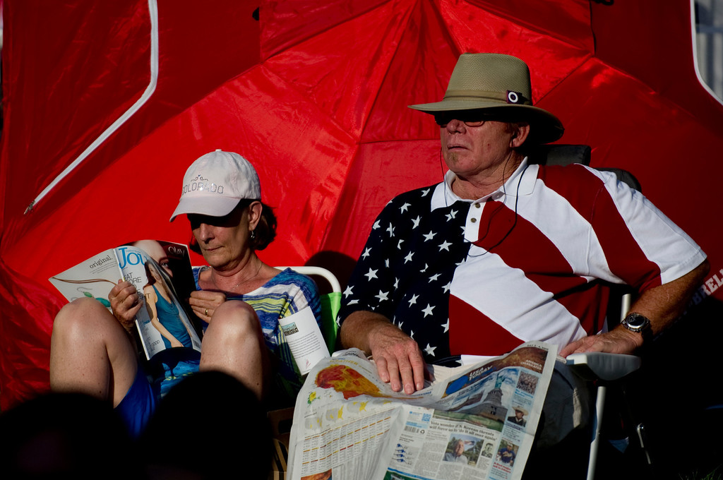. DENVER - JULY 3: Kathy and Rich Clawson read while waiting for the Colorado Symphony and fireworks at Civic Center Park in Denver on July 3, 2013. (Photo By Grant Hindsley/The Denver Post)