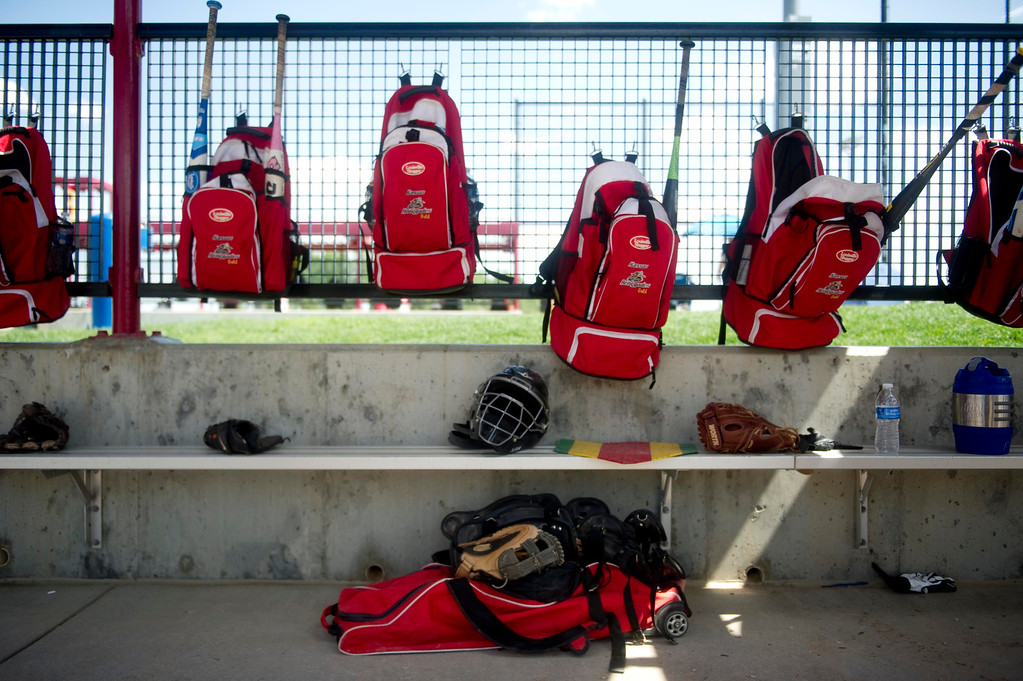 . AURORA, Co. - JULY 4: The Kansas Renegades\' softball bags hang within the dugout during a pool fast pitch softball game at Aurora Sports Park on July 4, 2013. (Photo By Grant Hindsley/The Denver Post)