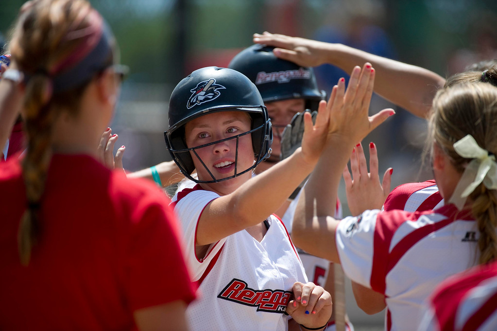 . AURORA, Co. - JULY 4: #2 of the Kansas Renegades high fives teammates after running one in during a pool play baseball game against the California Bears at the Colorado Fireworks 2013 softball tournament on July 4, 2013 at Aurora Sports Park. The tournament brings hundreds of teams from across the nation to compete against one another and is a hot spot for college scouts. (Photo By Grant Hindsley/The Denver Post)