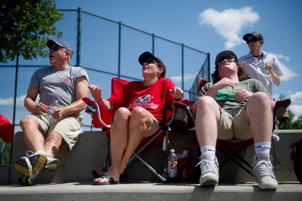 . AURORA, Co. - JULY 4:From left, Jerry Fassler, Jennifer Christensen, Chase Christensen, and Jesse Fassler react after a foul ball during a pool fast pitch softball game against the California Bears at the Colorado Fireworks 2013 softball tournament on July 4, 2013 at Aurora Sports Park. (Photo By Grant Hindsley/The Denver Post)