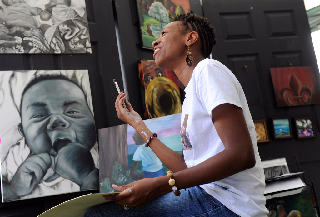 ". DENVER, CO - JULY13: Artist Letora Anderson works on one of her oil paintings during the festival. The 27th Annual Colorado Black Arts Festival takes place in City Park with this year\'s theme ""African American Style: an American Legacy. The festival continues through Sunday with dozens of artists, vendors, and performances taking place. (Photo By Kathryn Scott Osler/The Denver Post)"
