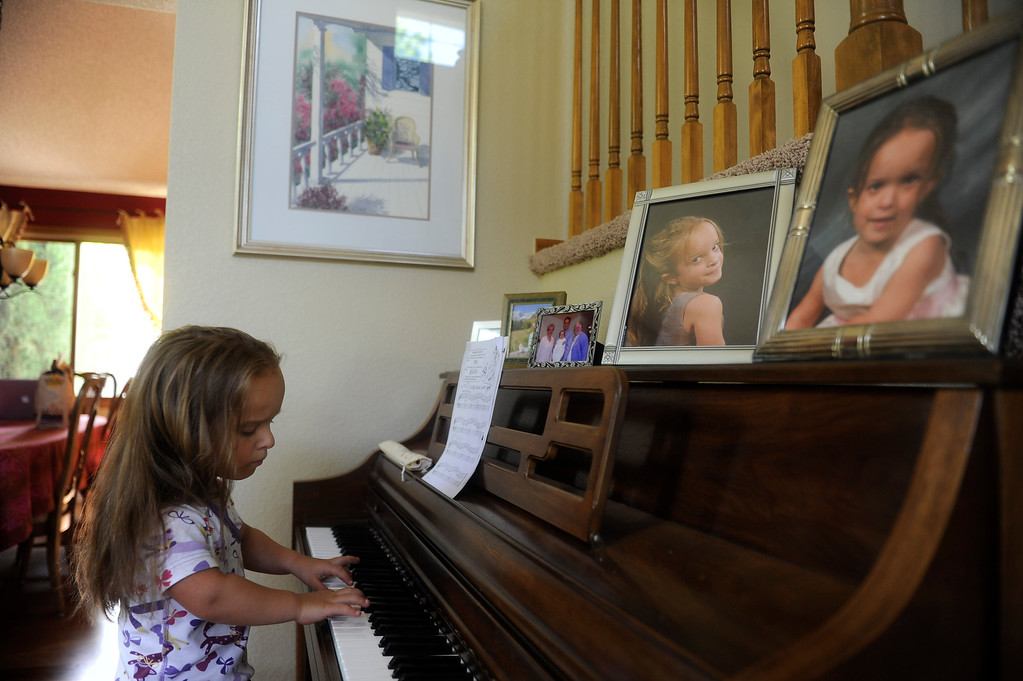 . GOLDEN, CO. - JUNE 25: Mia Towl, 9, practices piano before heading to the pool for swim practice on June 25, 2013.  (Photo By Grant Hindsley/The Denver Post)