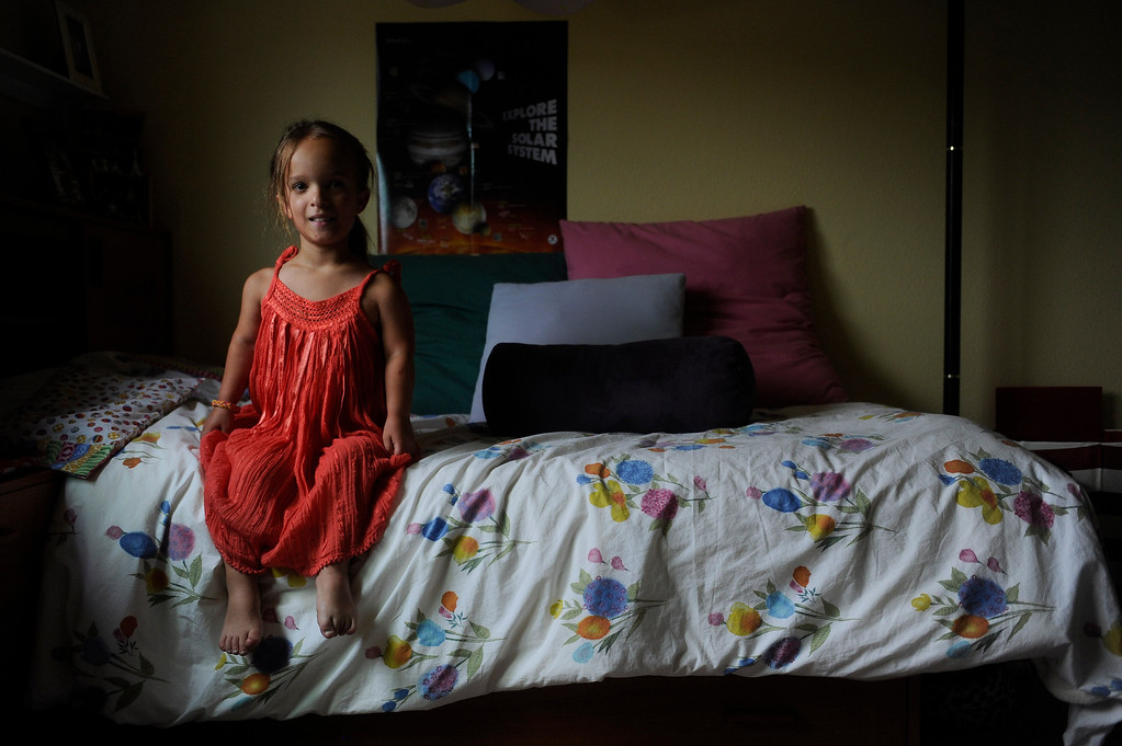 . GOLDEN, CO. - JUNE 22: Mia Towl, 9, poses for a portrait in her room on June 22, 2013. (Photo By Grant Hindsley/The Denver Post)