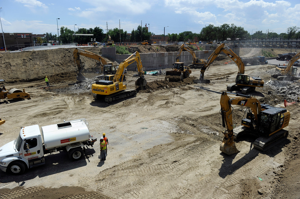. DENVER, CO - JULY 20: Crews prepare the area where the bridge will be placed. Closing I-70 in both directions over the weekend, the Colorado Department of Transportation (CDOT) will roll the new 2,400-ton Pecos Street bridge (that will go over I-70) approximately 800 feet down I-70 using a Self Propelled Modular Transporter - the first time this method has ever been used by CDOT. The bridge will make a 180 degree turn before being set in to its final resting place. The process will take about 50 hours, with I-70 re-opening on Monday morning. (Photo By Kathryn Scott Osler/The Denver Post)