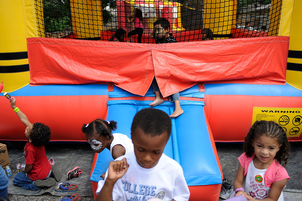 ". DENVER, CO. - AUG 3: Mayor Michael Hancock joins various events around Denver, CO on Aug. 3, 2013. The city is celebrating the first annual ""Denver Days,\"" a creation of Mayor Hancock.   Children climb around a bounce house at Cleave Memorial Church where a back to school extravaganza was thrown.    (Photo By Erin Hull/The Denver Post)"