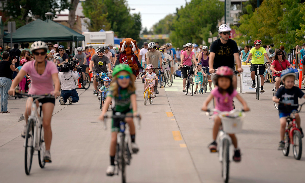 . Cyclist head down Tennyson Street as the festivities kick off for the LiveWell Colorado Viva Street bike festival August 11, 2013 in north Denver on Tennyson Street. The goal of Viva Streets is to introduce the public to the many benefits that come from increased walking and biking in our local communities, and highlight safe and active transportation. (Photo By John Leyba/The Denver Post)