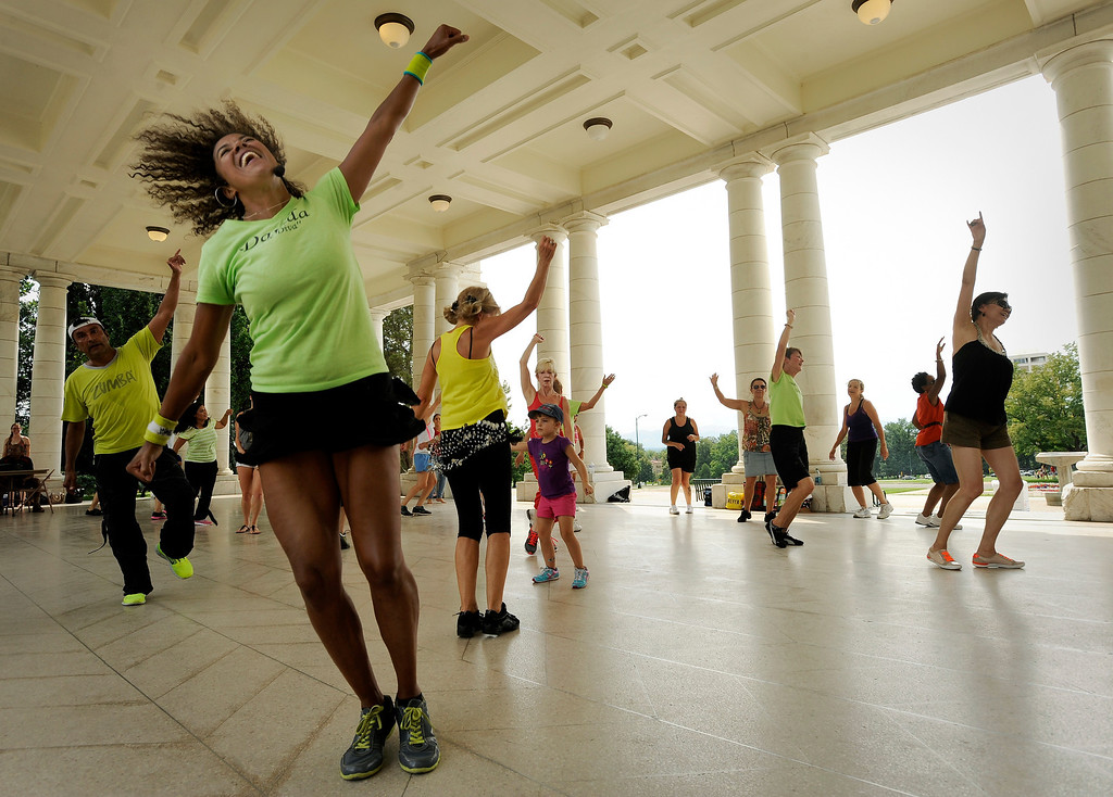 ". Davida Wright Galvin, left, fitness and dance instructor, gets down with a large group of people on August 18 for Salsa Central Denver\'s ""Summer Salsa and Bachata Bash\"" at Cheesman Park in the Walker Scott Cheesman Pavilion. Photo by Jamie Cotten, Special to The Denver Post"