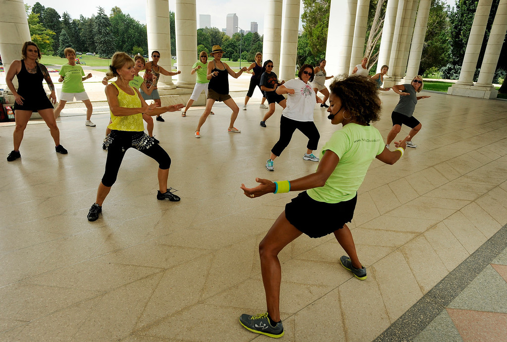 ". Davida Wright Galvin, right, fitness and dance instructor, shows a group of people how to zumba on August 18 for Salsa Central Denver\'s ""Summer Salsa and Bachata Bash\"" at Cheesman Park in the Walker Scott Cheesman Pavilion. Photo by Jamie Cotten, Special to The Denver Post"