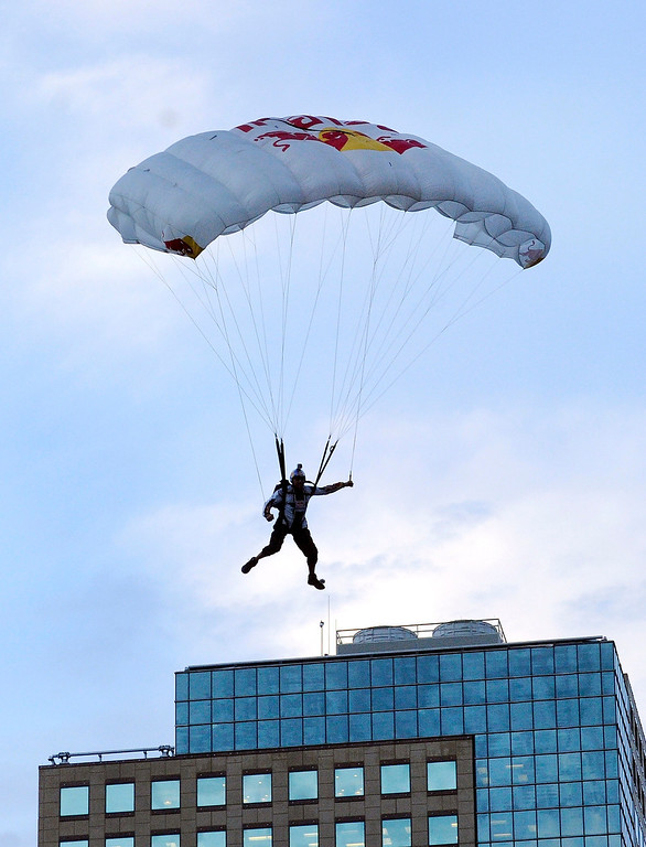 . Jeff Provenzano came in for a smooth landing Tuesday night after he and basejumping partner Miles Daisher leapt off the top of the Four Seasons Hotel in downtown Denver. Photo By Karl Gehring/The Denver Post