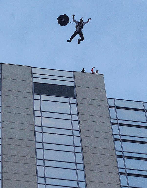 . Jeff Provenzano jumped from the roof and did a free fall for several seconds while BASE jumping from the roof of the Four Seasons Hotel in downtown Denver.  Photo By Karl Gehring/The Denver Post