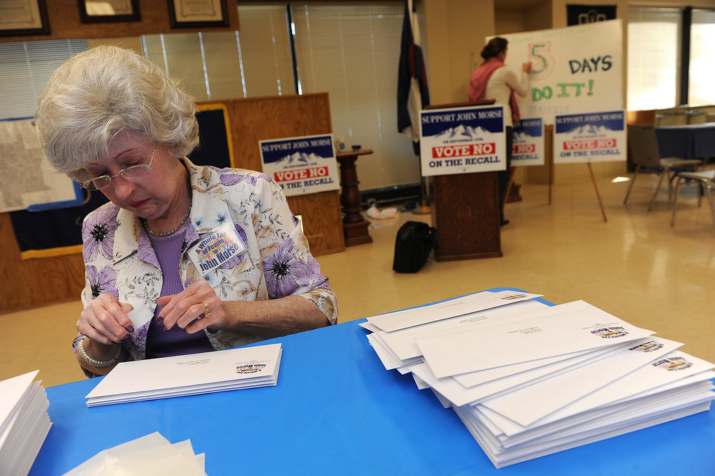 . COLORADO SPRINGS, CO - SEPTEMBER 5, 2013:  Mary Beth Morse, mother of Senator John Morse, helps place stamps on letters that will be sent out to votes to get the vote out for the recall election in Colorado Springs, CO on September 5, 2013, at their campaign headquarters at 2864 Janitell Road.  Early voting started in Colorado Springs, CO on Thursday September 5, 2013, to recall State Senator and Senate President John Morse for his support of gun control legislation that passed earlier this year.  Photo by Helen H. Richardson/The Denver Post