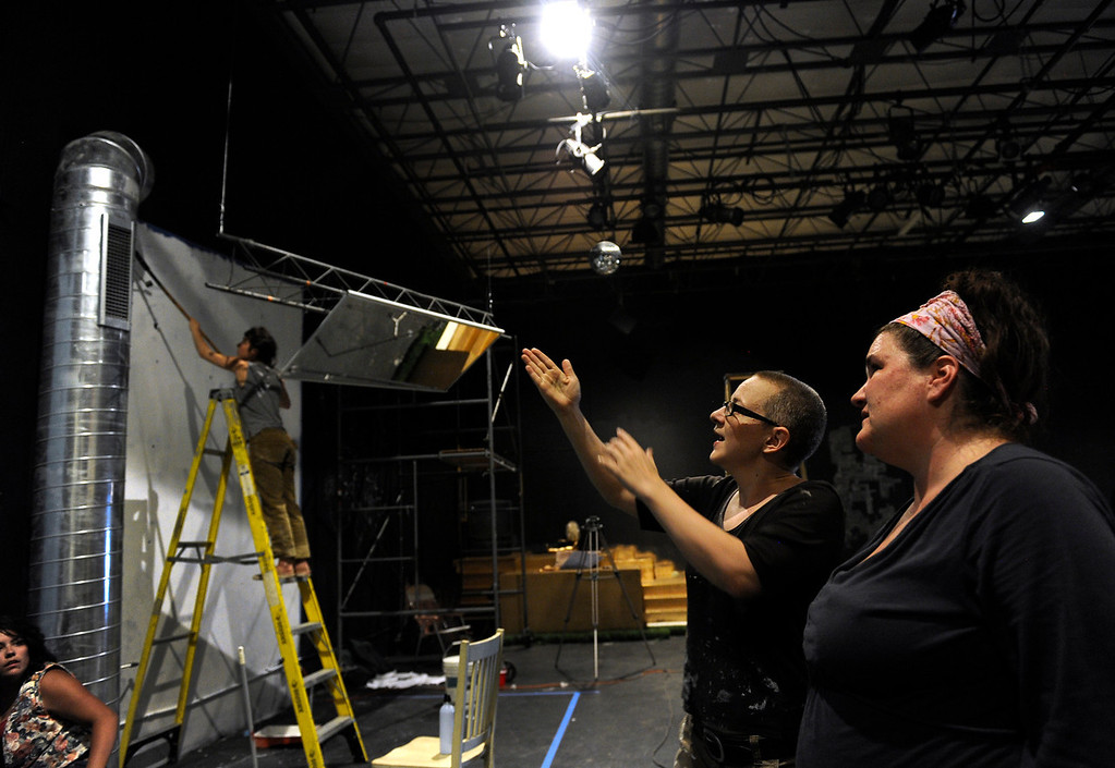 ". DENVER, CO - Aug.16: One week before her surgery, Erin Rollman, second from right, is hard at work with fellow company member Hannah Duggan as they build the set for  upcoming show ""Some Kind of Fun\"" with friend and Screw Tooth director Adam Stone. (Photo By Kathryn Scott Osler/The Denver Post)"
