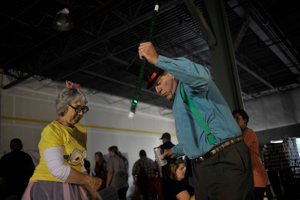 . ARVADA, CO. - SEPTEMBER 13: Fran Helfrich of Aurora and Bill Short of Greenwood Village dance during HindmanSanchez Law Firm\'s annual Community Can-Can food donation drive and sculpture contest in Arvada Friday afternoon, September 13, 2013. (Photo by Patrick Traylor/The Denver Post)