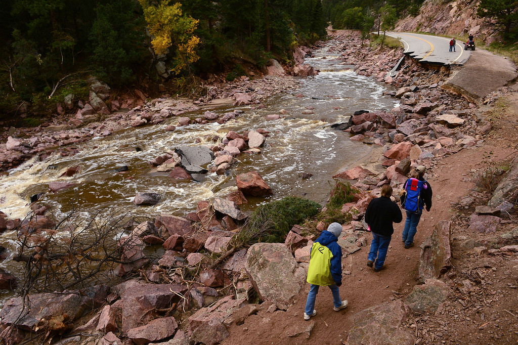 . Pinewood Springs residents use a  new trail next to the Little Thompson River, and what used to be Highway 36, west of Pinewood Springs on September 22, 2013, to ferry goods in and out. and also as a route to and from Estes Park.   (Photo By Helen H. Richardson/ The Denver Post)