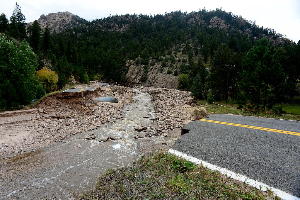 . The Little Thompson river became a raging river during the floods, and what is left behind is a transformed landscape of that river along Highway 36 just east of Estes Park on September 22, 2013. County Road 42 is now completely cut off from access to Highway 36 near Pinewood Springs.  (Photo By Helen H. Richardson/ The Denver Post)