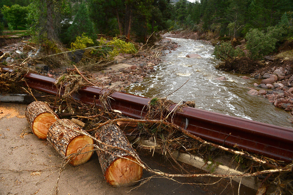 . A portion of a bridge left on Cree Court in a neighborhood in Pinewood Springs, Colorado, on September 22, 2103  is packed with debris from the flood. Iroquois Road used to run beneath but is no longer there. Instead what is left behind is completely washed out.    (Photo By Helen H. Richardson/ The Denver Post)