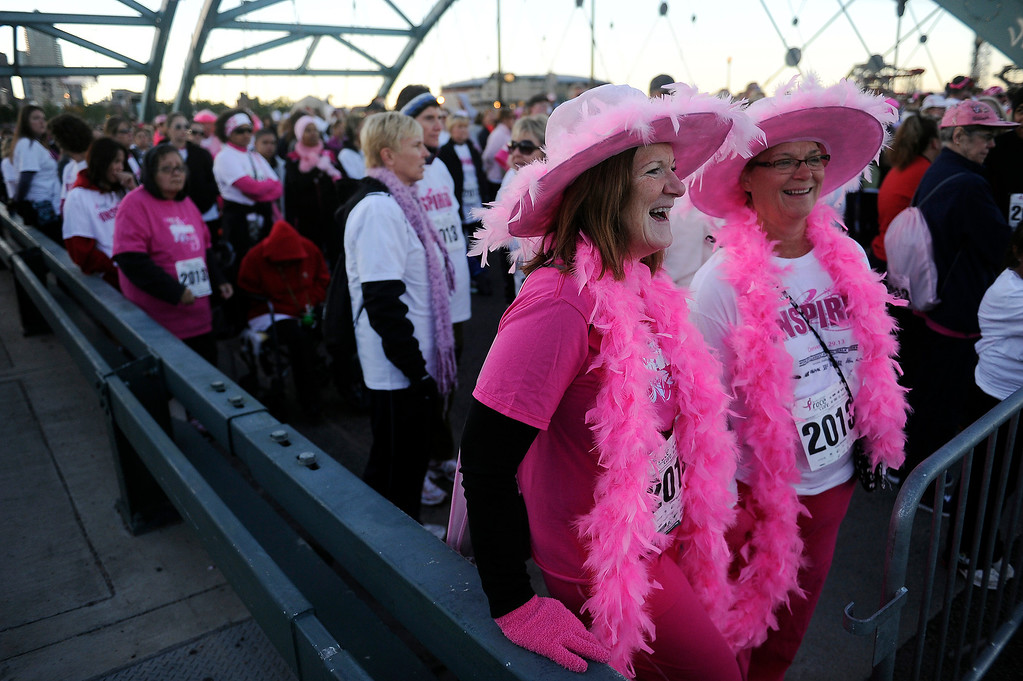 . DENVER, CO - SEPTEMBER 29: Cindy Bird, left, and her sister, Sharon Long, laugh as they wait for the start of the second race during the Susan G Komen Race for the Cure in Denver, Colorado on September 29, 2013. Approximately 30,000 people participated in this years race. (Photo by Seth McConnell/The Denver Post)