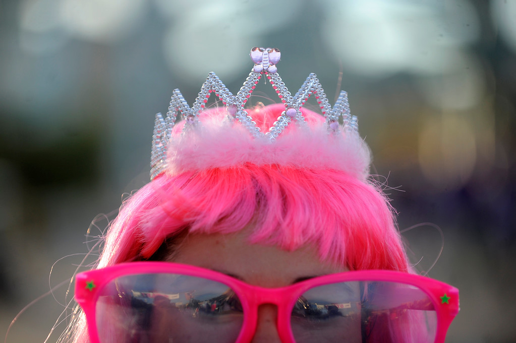 . DENVER, CO - SEPTEMBER 29: Michele Long shows off her bright pink wig, glasses and tiara during the Susan G Komen Race for the Cure in Denver, Colorado on September 29, 2013. Approximately 30,000 people participated in this years race.  (Photo by Seth McConnell/The Denver Post)