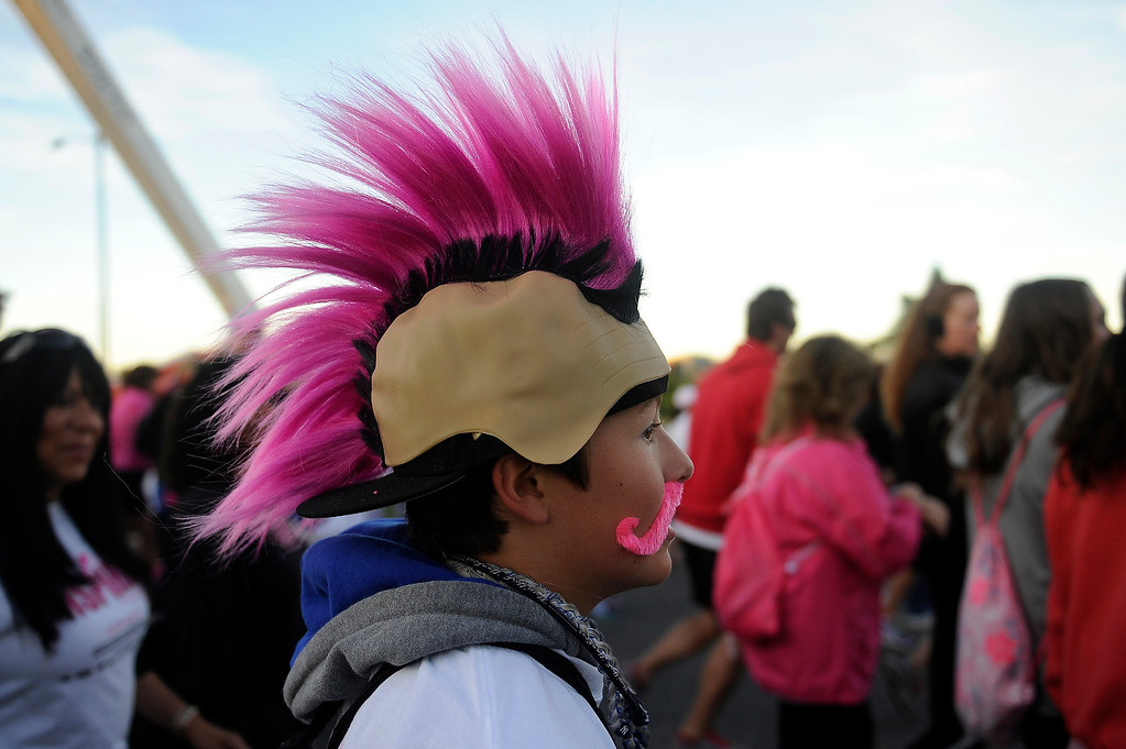 . DENVER, CO - SEPTEMBER 29: Evan Schwarz, 13, sports a pink mohawk during the Susan G Komen Race for the Cure in Denver, Colorado on September 29, 2013. Approximately 30,000 people participated in this years race. (Photo by Seth McConnell/The Denver Post)