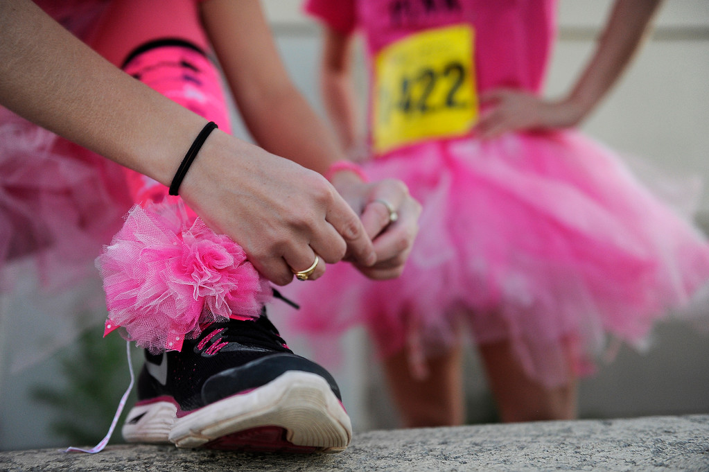 . DENVER, CO - SEPTEMBER 29: Daphne Haubenschild laces up her shoes before the start of the race during the Susan G Komen Race for the Cure in Denver, Colorado on September 29, 2013. Approximately 30,000 people participated in this years race. (Photo by Seth McConnell/The Denver Post)