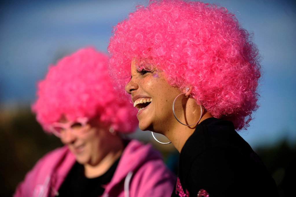 . DENVER, CO - SEPTEMBER 29: Christina Echeman laughs as she talks with her race team during the Susan G Komen Race for the Cure in Denver, Colorado on September 29, 2013. Approximately 30,000 people participated in this years race. (Photo by Seth McConnell/The Denver Post)