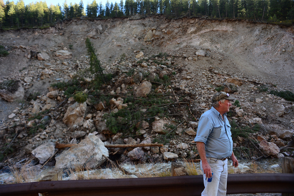 . DRAKE, CO - OCTOBER 1: Richard McGurn looks at a massive portion of the mountain that collapsed into the Big Thompson River along Highway 34 west of Drake, Co  on October 1, 2013.   (Photo By Helen H. Richardson/ The Denver Post)