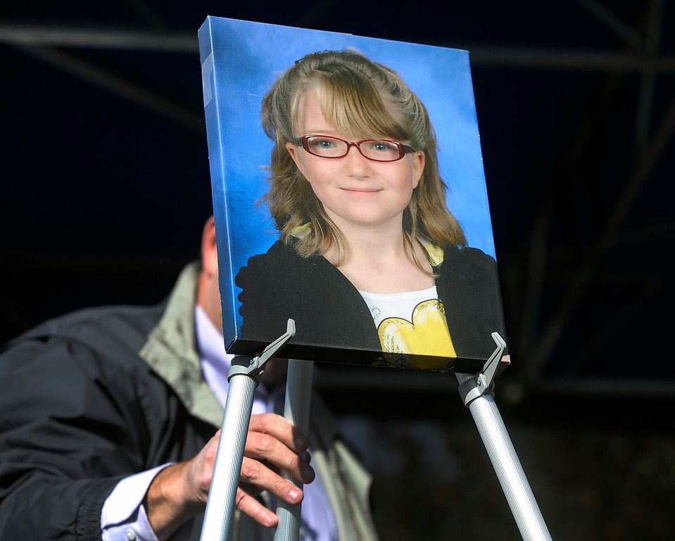 . WESTMINSTER, CO - Oct. 5: A photograph of Jessica is place prominently up on a stage for the dedication. A year to the day since Jessica Ridgeway went missing, a dedication ceremony takes place in her memory at the Jessica Ridgeway Memorial Park. Jessica\'s family and hundreds of others gather at the newly renovated park (much of the playground equipment made in Jessica\'s favorite color purple) that came together through the dedication of volunteers throughout the community. (Photo By Kathryn Scott Osler/The Denver Post)