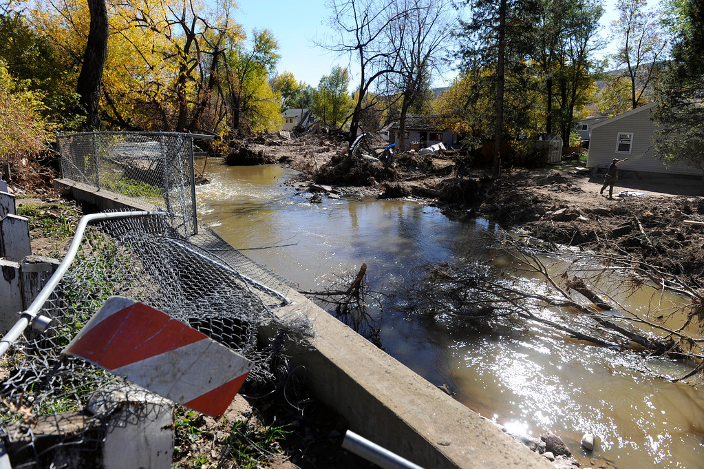 . LYONS, CO - Oct. 26: Even as thousands of residents have utilities restored to their homes, much of Lyons, especially on the south side of town,  is still devastated and working to recover. About 1,000 residents from the city of Lyons are expected to return home this weekend as water, sewage and gas are restored in homes. The town has been without utilities since mid-September after the St. Vrain River flooded homes and businesses and damaged the town\'s electric, water and sewer lines forcing community-wide evacuations. Crews have shattered original predicted timelines of at least three months for when utilities would be restored. (Photo By Kathryn Scott Osler/The Denver Post)