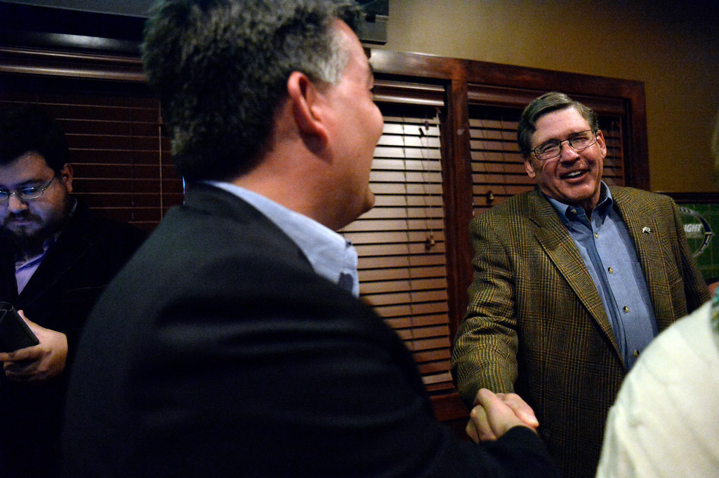 . CASTLE ROCK, CO - NOVEMBER 05: Douglas County School Board candidate Jim Geddes (R) shakes hand with Congressman Cory Gardner as they gather at the Fowl Line November 5, 2013 on election night. (Photo by John Leyba/The Denver Post)