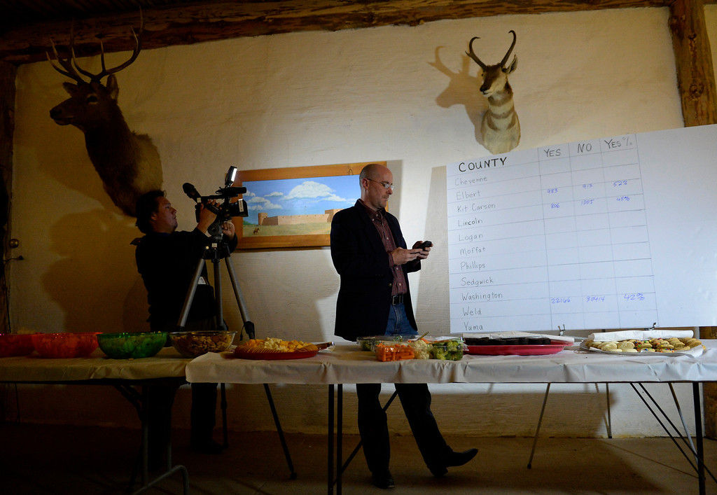 . FORT LUPTON, CO - NOVEMBER 05: Jeffrey Hare, center, of the 51st State Initiative, checks results during an election result watch party at the Historic Fort Lupton Fort, November 05, 2013. Eleven counties are voting to secede from Colorado to form the 51st state. (Photo By RJ Sangosti/The Denver Post)