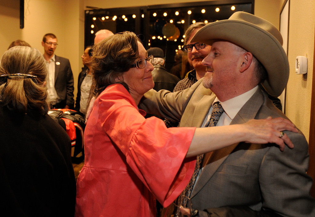 . DENVER, CO - NOVEMBER 5 :   District 3 candidate for the Denver School Board Meg Schomp, left, hugs Rick Van Wie as she gathered with supporters on Tuesday, November 5, 2013 at Angelo\'s Taverna on 6th Ave. (Photo By Cyrus McCrimmon/The Denver Post)