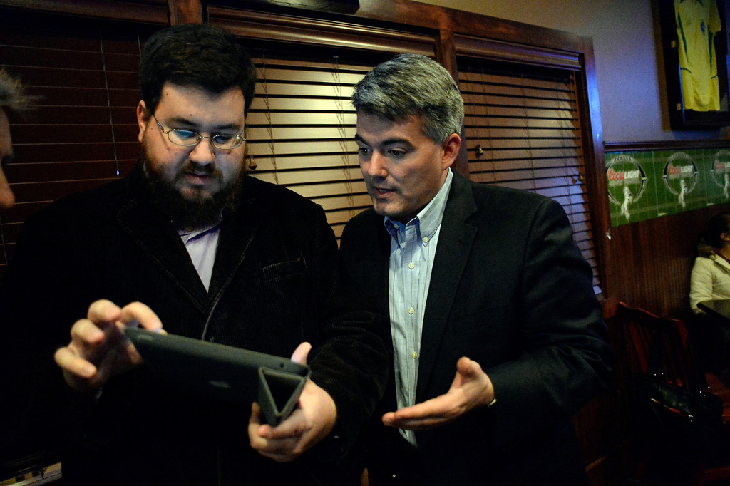 . CASTLE ROCK, CO - NOVEMBER 05: Congressman Cory Gardner (R) looks over returns for Douglas County School Board  at the Fowl Line November 5, 2013 on election night. (Photo by John Leyba/The Denver Post)