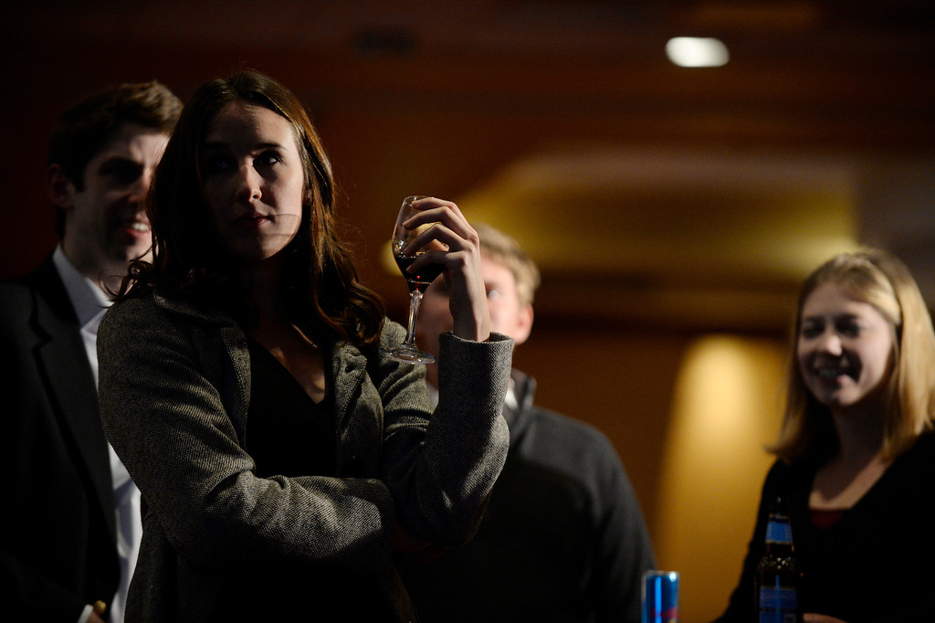 . DENVER, CO. - NOVEMBER 05:  Carlie Duncan of Gov  John Hickenlooper staff studies incoming results during a watch party for supporters of Amendment 66 at the Marriott City Center in Denver, CO November 05, 2013. Amendment 66 proposes a $950 million tax increase along with a restructuring of Colorado\'s K-12 school finance system. (Photo By Craig F. Walker / The Denver Post)
