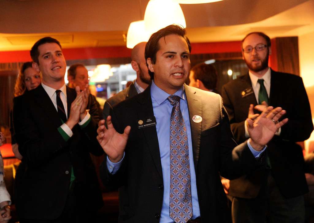 . DENVER, CO. - NOVEMBER 5: Representative Dan Pabon, center, (D) Denver, spoke to a small crowd of proponents for Proposition AA at a victory partyTuesday night, November 5, 2013 in downtown Denver.  Proposition AA would impose a pair of taxes on legal marijuana sales. (Photo By Karl Gehring/The Denver Post)