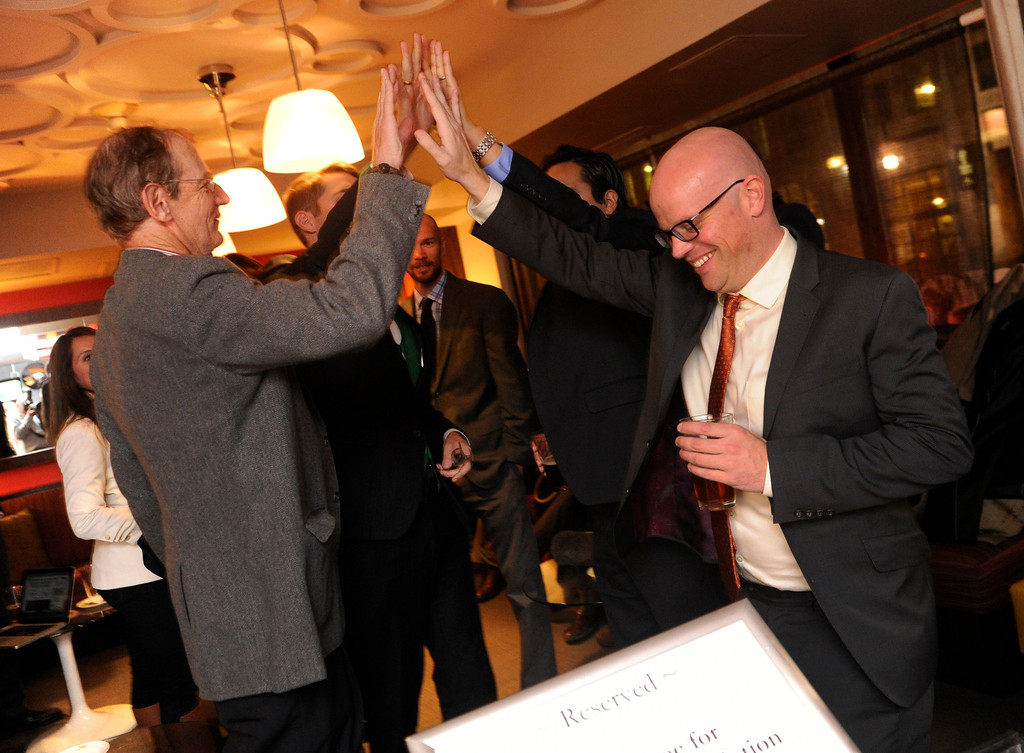 . DENVER, CO. - NOVEMBER 5: Advocates for Proposition AA celebrated Tuesday night, November 5, 2013 after the Associated Press and the Denver Post called the vote in their favor. Rick Ridder, left, high-fived Christian Sederberg, right, at a victor party in downtown Denver. Proposition AA would impose a pair of taxes on legal marijuana sales. (Photo By Karl Gehring/The Denver Post)
