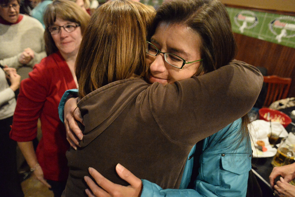 . CASTLE ROCK, CO - NOVEMBER 05: Douglas County School Board candidates Meghann Silverthorn gets a hug from a supporter as they celebrate at the Fowl Line November 5, 2013 on election night. (Photo by John Leyba/The Denver Post)