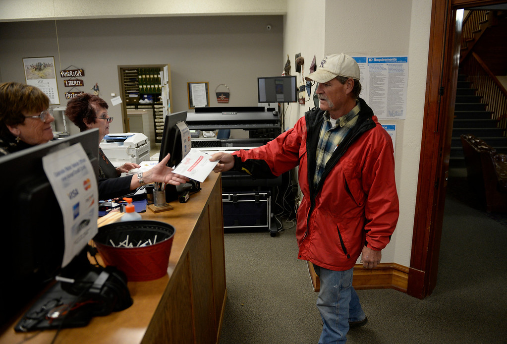 . CHEYENNE WELLS, CO - NOVEMBER 05: Ron Smith drops off his ballot in Cheyenne Wells, November 05, 2013. Smith voted not to secede from Colorado as eleven counties, including Cheyenne County where he lives, got the chance to vote to secede from Colorado to form the 51st state. (Photo By RJ Sangosti/The Denver Post)
