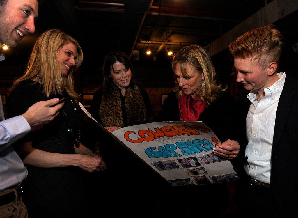 . DENVER, CO - NOV. 5: Newly-elected Denver School Board member Barbara O\'Brien, second from right, receives an over-sized card from her campaign staff. Denver Public School Board candidates supporting Superintendent Tom Boasberg\'s reforms host their election night party at the Irish Snug. (Photo By Kathryn Scott Osler/The Denver Post)