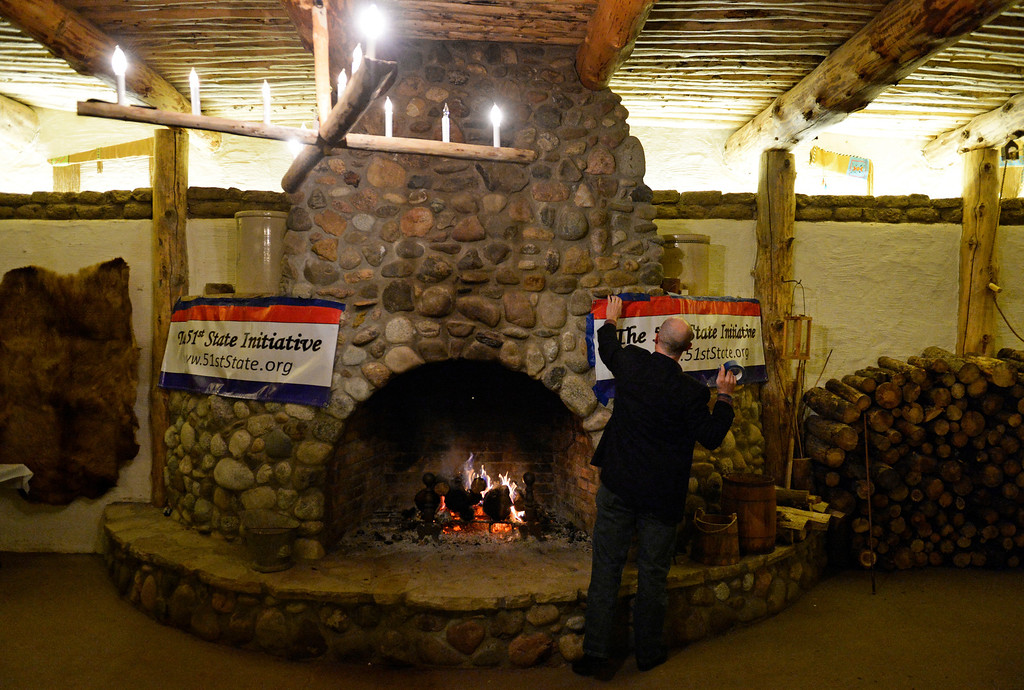 . FORT LUPTON, CO - NOVEMBER 05: Jeffrey Hare, of the 51st State Initiative, hangs a banner before a election result watch party at the Historic Fort Lupton Fort, November 05, 2013. Eleven counties are voting to secede from Colorado to form the 51st state. (Photo By RJ Sangosti/The Denver Post)