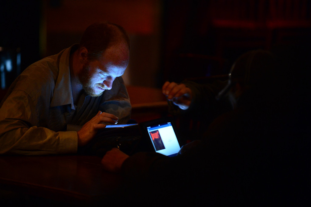 . DENVER, CO - NOVEMBER 5, 2013: Jon Lorenzo and other anti AA proposition folks carefully watch as the results start to come in at Casselman\'s Bar and Venue in Denver, CO on November 5, 2013. Proposition AA is Colorado\' statewide initiative to tax marijuana. (Photo By Helen H. Richardson/ The Denver Post)