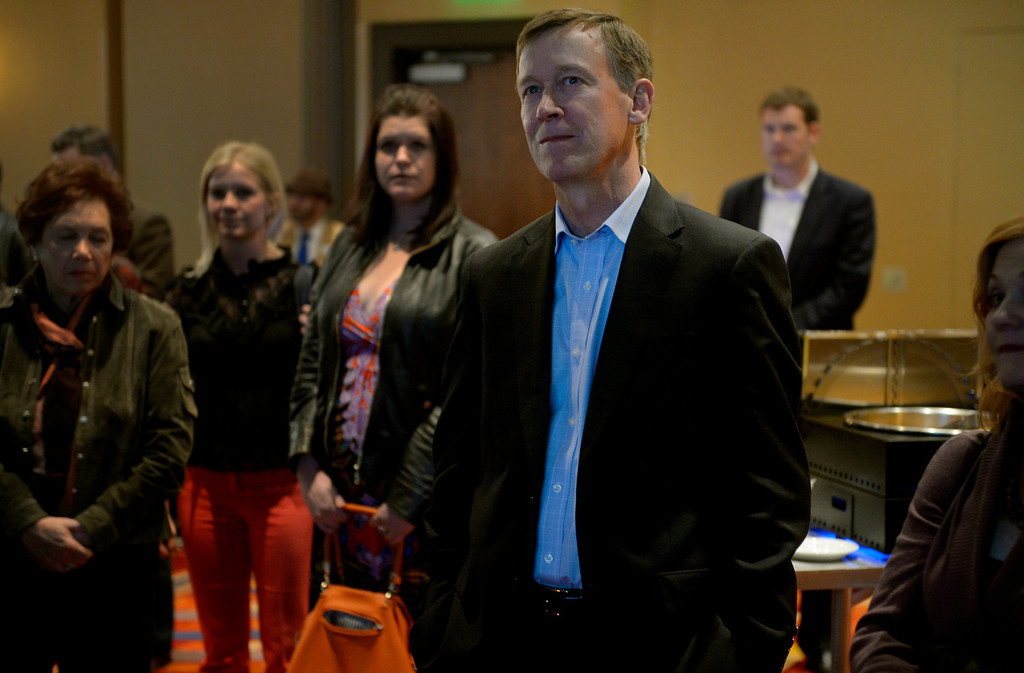 . DENVER, CO. - NOVEMBER 05:  Gov. John Hickenlooper watches a presentation before speaking at a watch party for supporters of Amendment 66 at the Marriott City Center in Denver, CO November 05, 2013. Amendment 66 proposes a $950 million tax increase along with a restructuring of Colorado\'s K-12 school finance system. (Photo By Craig F. Walker / The Denver Post)